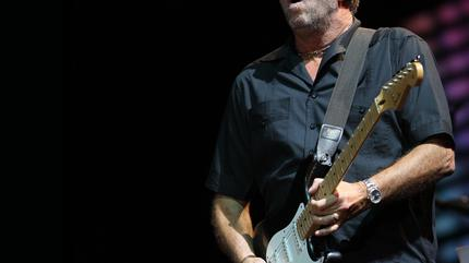 Foto de Eric Clapton tocando la guitarra