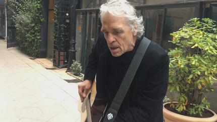 Abel Ferrara playing guitar
